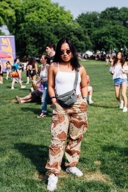 Fashionista.com Street Style At 2018 Governors Ball. #camo #camopants #fannypack